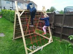 Handmade wooden climbing pyramid frame
