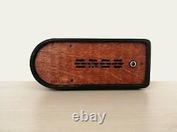 Nixie tube clock with a dekatron tube in teak wooden case