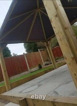 Sturdy wooden gazebo handmade with roof